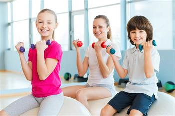 Kids using dumbells