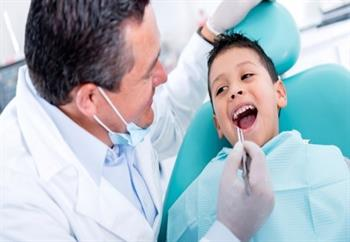 Dental exam of little boy