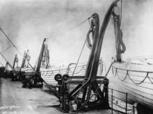 The lifeboats sit in their davits on the Titanic soon before the ship set off. April 1912.
